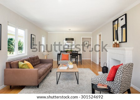 Modern interior with white fire place, designer table, couch, chair, pillows.  - stock photo