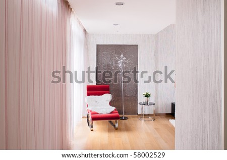 Modern interiors with longue chair by the window - stock photo