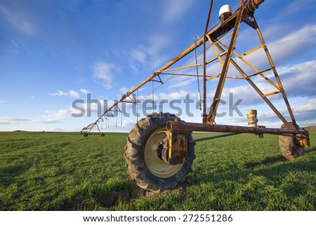 Modern irrigation system on a farm field  - stock photo