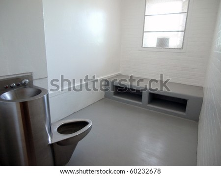 Modern jail cell in a closed government owned facility. - stock photo