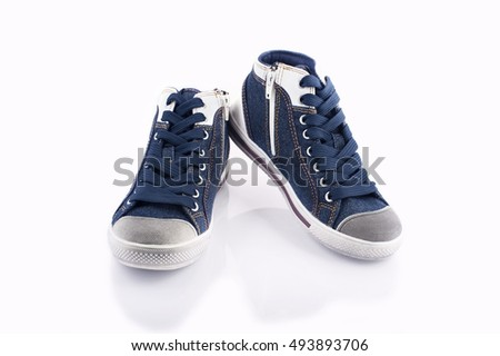 Modern jeans sneakers closeup isolated on white