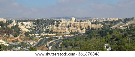 Modern Jerusalem panorama view. Modern office buildings of the holy city Jerusalem, mountains and roads with green trees - stock photo
