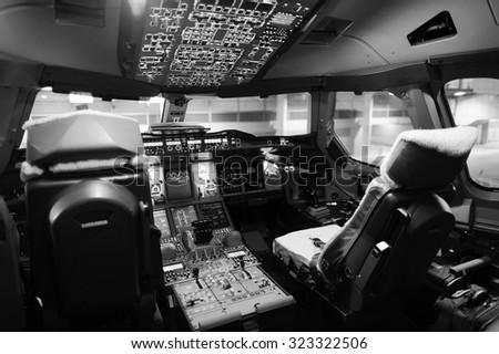 Modern jet aircraft cockpit interior - stock photo