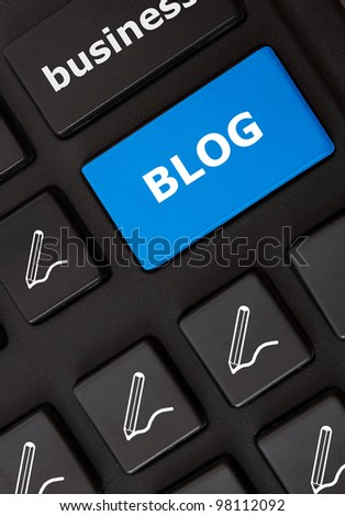 Modern keyboard with blog text and written pen symbols. Blog concept