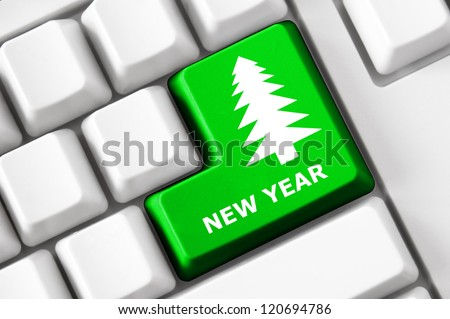 Modern keyboard with color button, fir image and new year text. Concept - stock photo