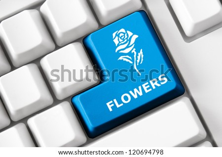 Modern keyboard with color button, rose image and flower text. Concept