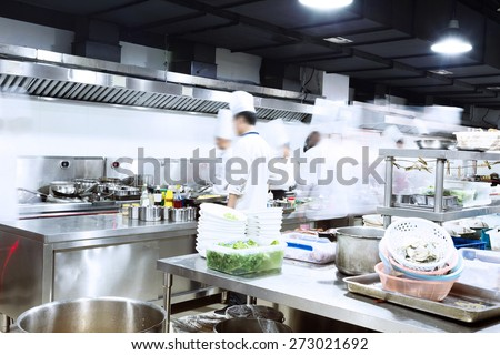 modern kitchen and busy chefs of hotel - stock photo