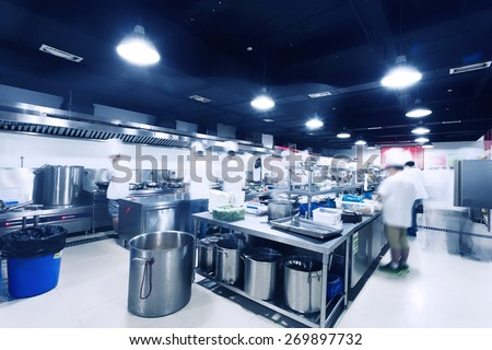 modern kitchen and chefs in hotel  - stock photo