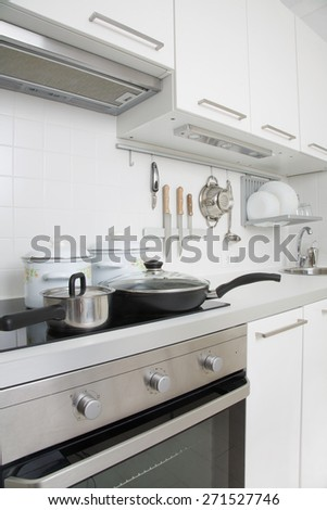 Modern kitchen at home with kitchenware - stock photo