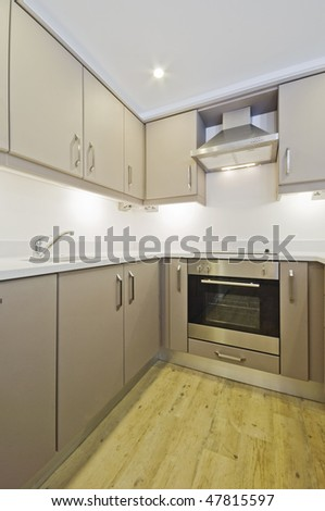 modern kitchen counter with stainless steel electric oven - stock photo