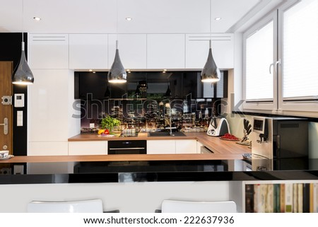 Modern kitchen in black and white design  - stock photo