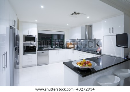 Modern kitchen in luxury Australian mansion - stock photo