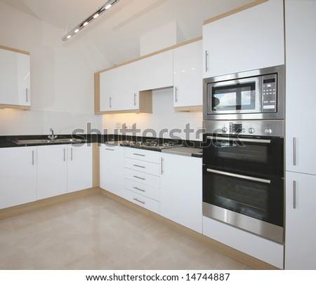 Modern kitchen in white - stock photo