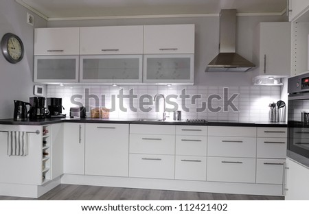 Modern kitchen in white color - stock photo