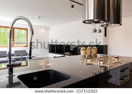 Modern Kitchen Interior With A High Polished Countertop And Sink