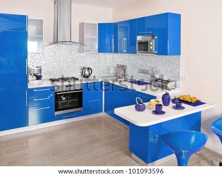 Modern kitchen interior with blue decoration - stock photo