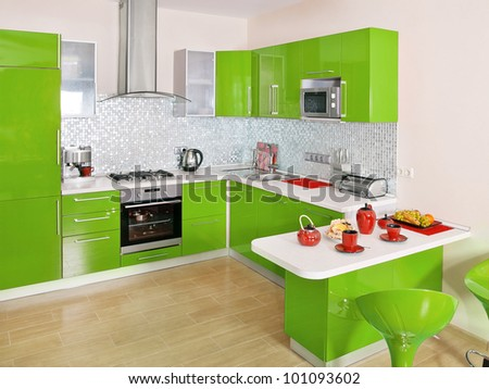 Modern kitchen interior with green decoration - stock photo