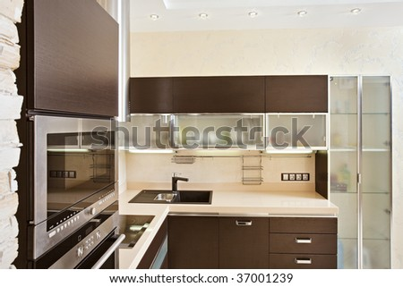 Modern Kitchen interior with hardwood Furniture on wide angle view - stock photo