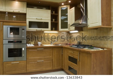 Modern kitchen interior with integrated appliances. - stock photo