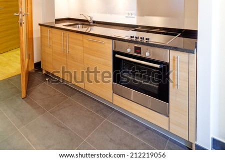 modern kitchen interior with sink and appliances - stock photo