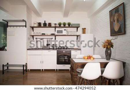 Modern kitchen interior with white brick wall and wooden floor