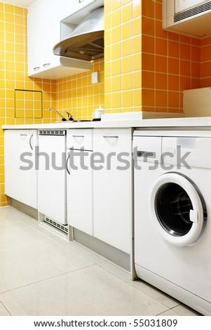 Modern kitchen interior with yellow walls - stock photo