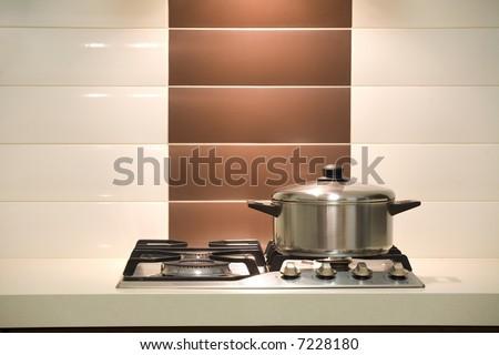 Modern kitchen / Saucepan on an oven - stock photo