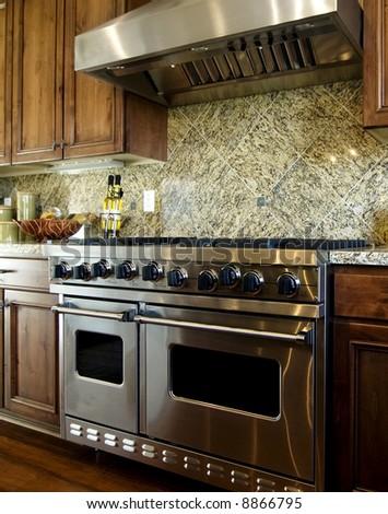 Modern kitchen stove and hood - stock photo