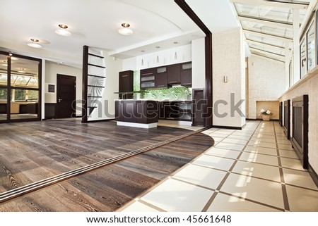 Modern Kitchen (studio) interior with balcony and dark wooden floor, corner wide angle view from below - stock photo
