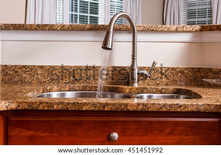 Modern Kitchen Water Fixture with Water Running - stock photo