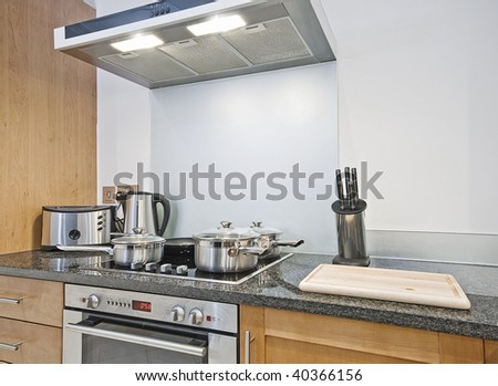 modern kitchen with a wide range of appliances and tools - stock photo
