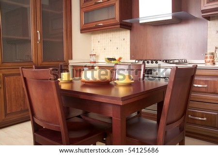 Modern Kitchen with Cherry drawers and kitchen furniture - stock photo