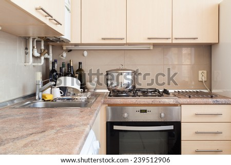 Modern kitchen with dishes - stock photo