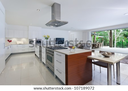 Modern kitchen with stainless steel appliances in Australian mansion