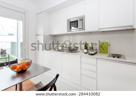 modern kitchen with white furniture - stock photo