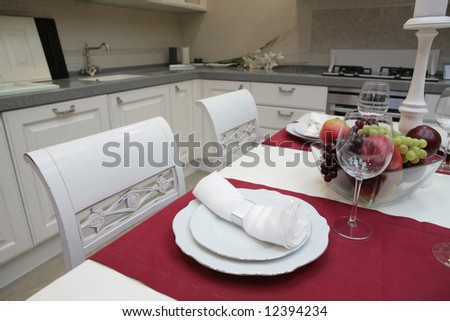 modern kitchen with white furniture in classical style and with served table