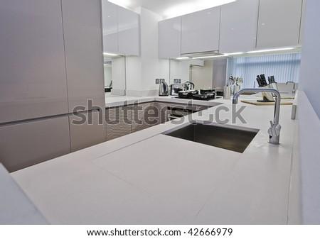 modern kitchen with white sand stone worktop - stock photo