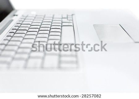 modern laptop extreme close up with very shallow dof - stock photo
