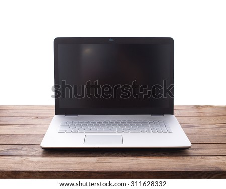 Modern laptop on wooden table isolated on white background. Mock up for design. Front view - stock photo