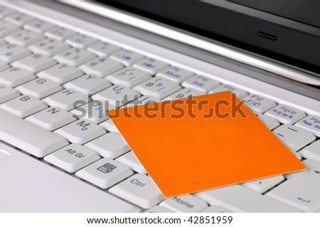 Modern laptop with blank card on it - stock photo