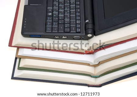 modern laptop with colorful books - stock photo