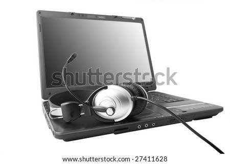 modern laptop with ear-phones lying on the keyboard - stock photo