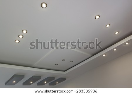 Modern layered ceiling with embedded lights, view 4