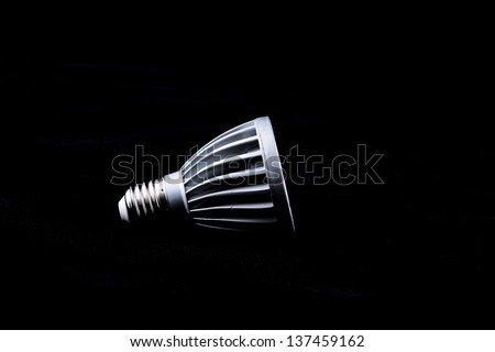 Modern led lights bulb isolated of black. - stock photo