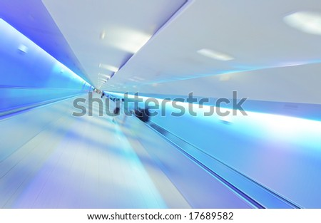 Modern Lifestyle - Fast Moving on Airport Tunnel - stock photo