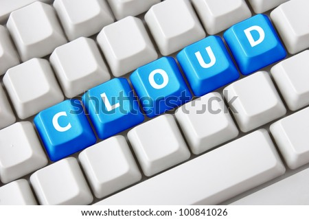 Modern light computer keyboard with a cloud text on buttons. Cloud computing concept