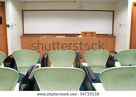 Modern light green Seat arrangement in University lecture room