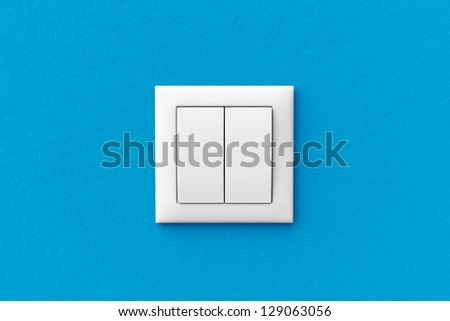 Modern light switch on a blue wall - stock photo
