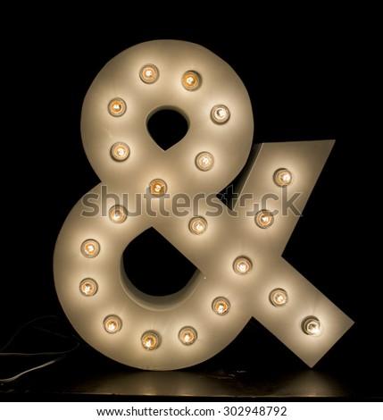 "modern lighting ""&"" symbol isolated on black background - stock photo"