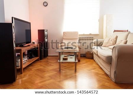 Modern living room - ambient light, daylight shot - stock photo